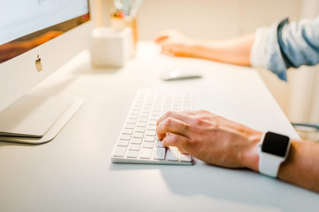 Man using a keyboard searching for backlinks